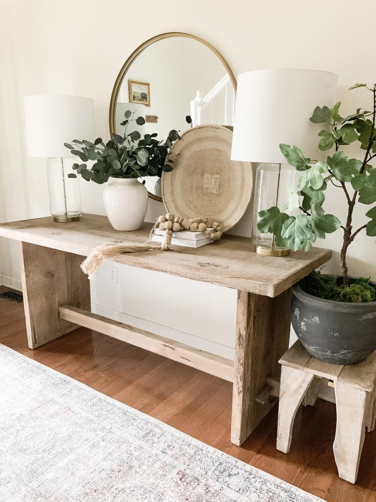 entryway table with Alabaster on walls