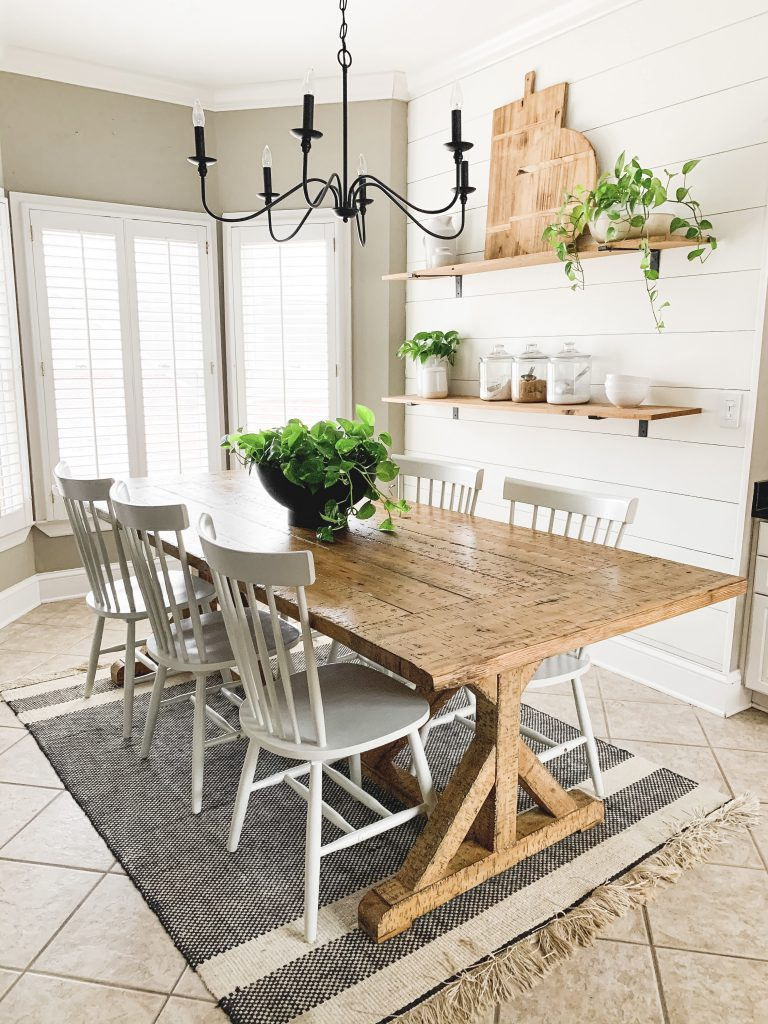 shiplap wall in kitchen eating area painted with Alabaster Sherwin Williams