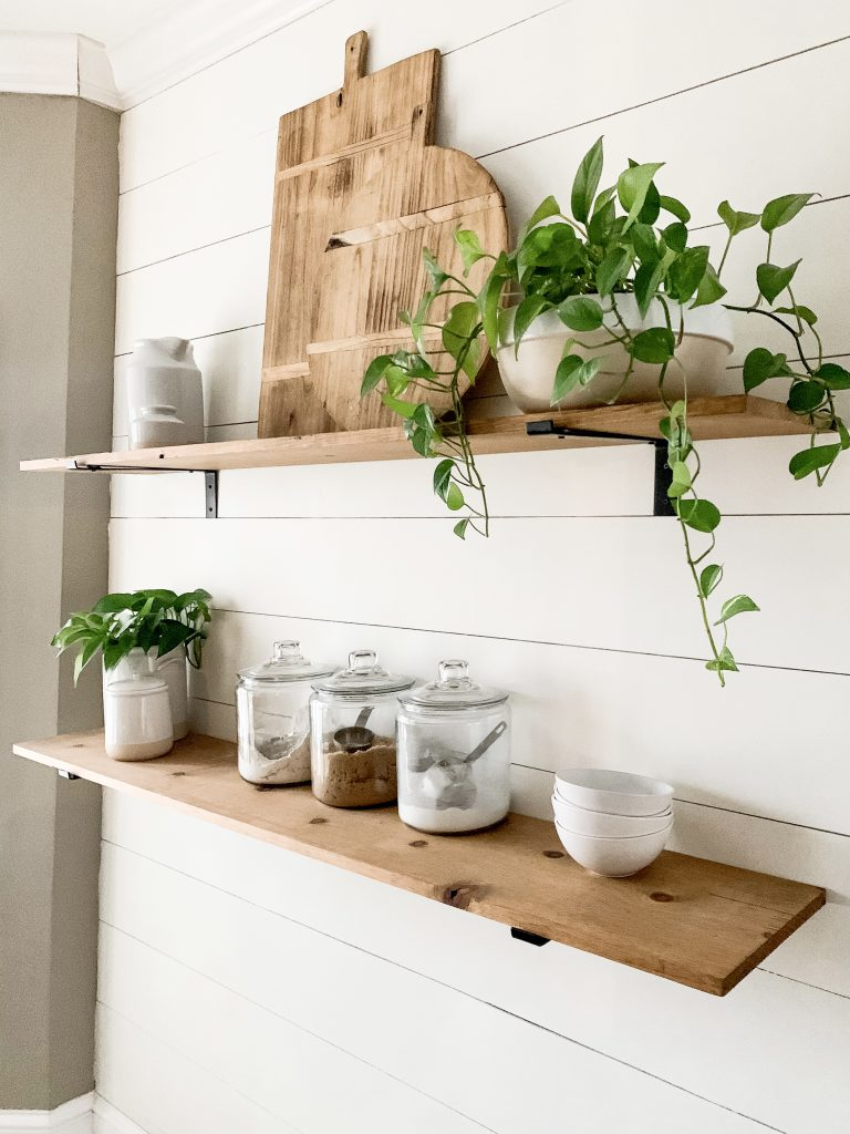 wood shelves in kitchen on shiplap wall