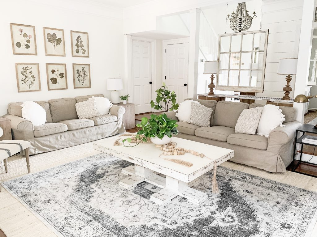 living room with white coffee table and 2 sofas