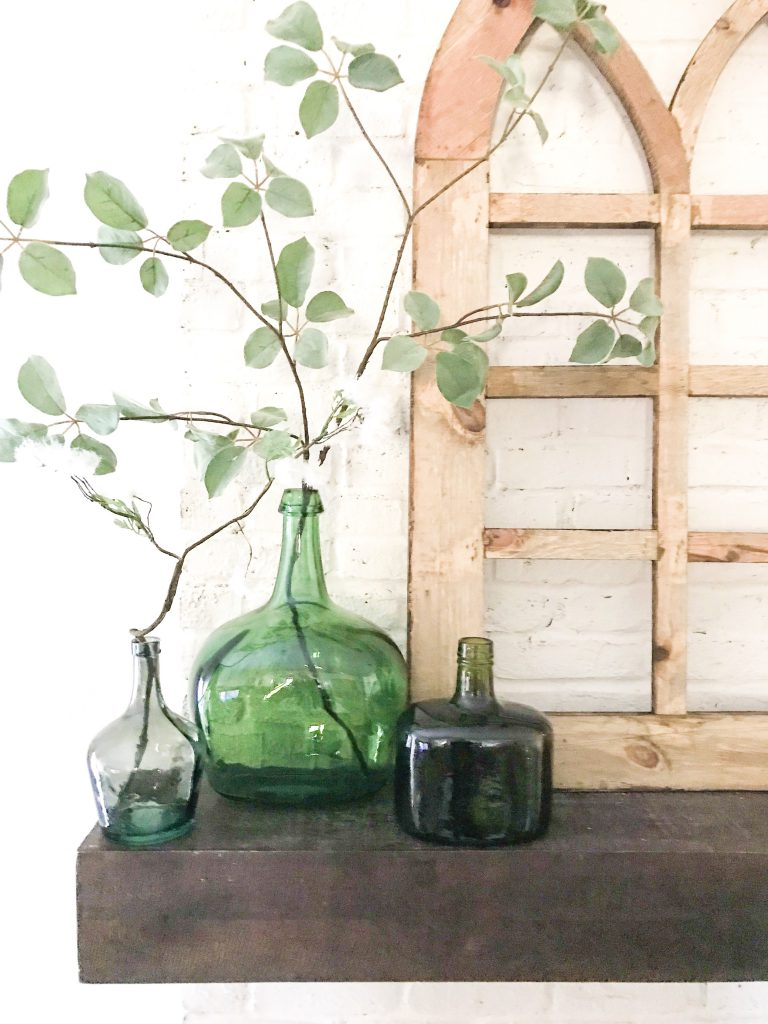 green bottles on mantel