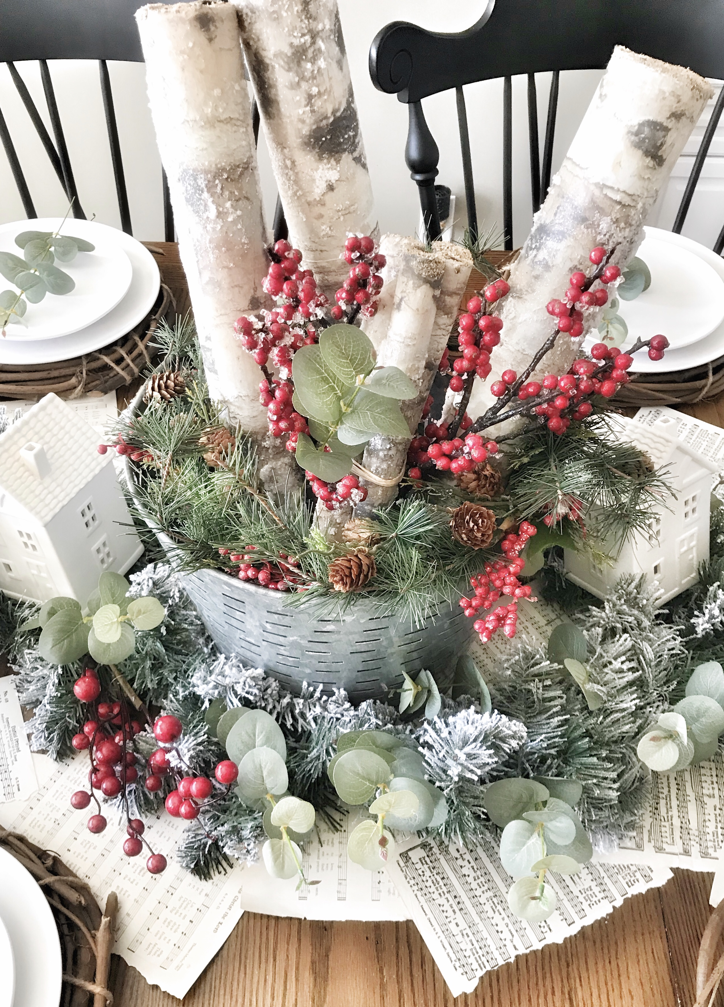 Christmas table centerpiece with wood and greenery