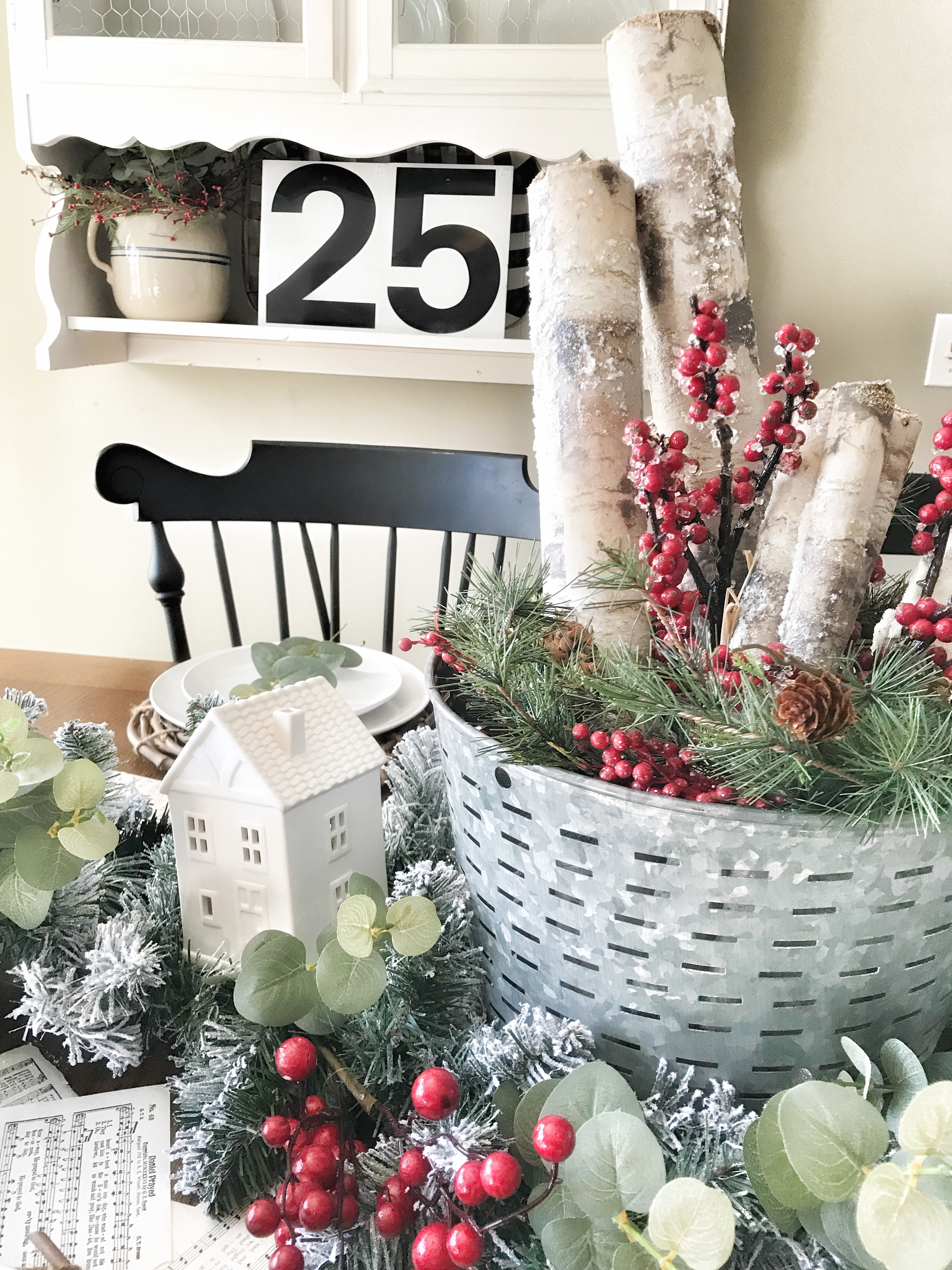 Christmas table decor with white cottages and garland