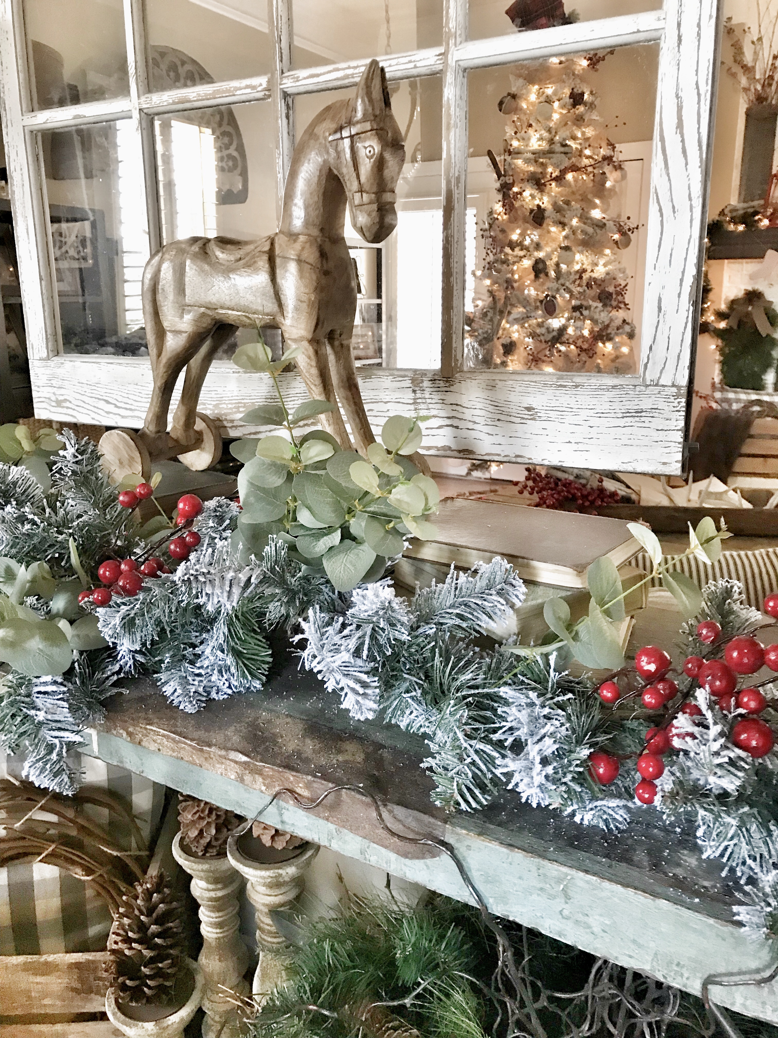 Christmas home tour flocked garland and wooden horse