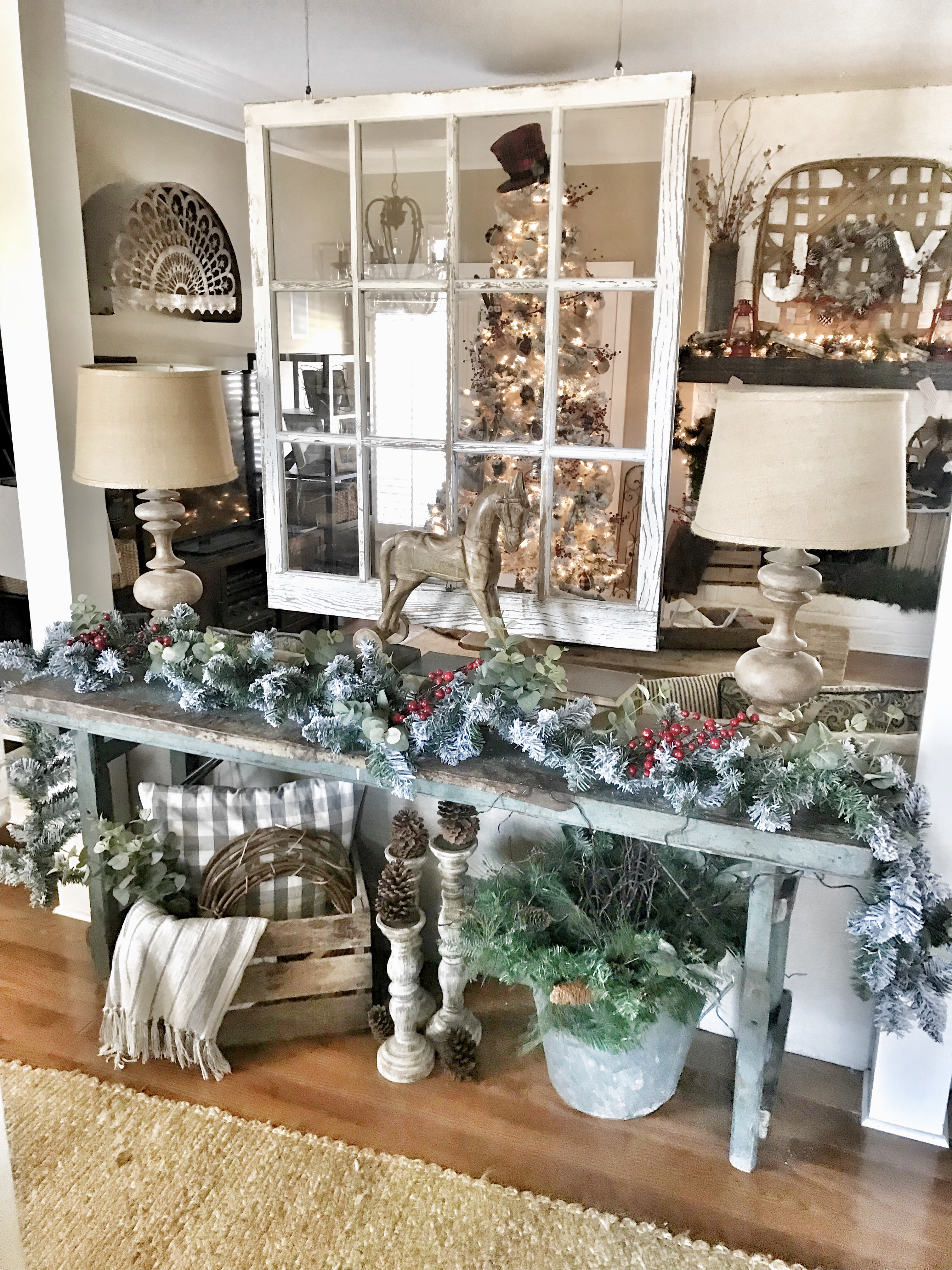 console table with flocked garland and Christmas decor