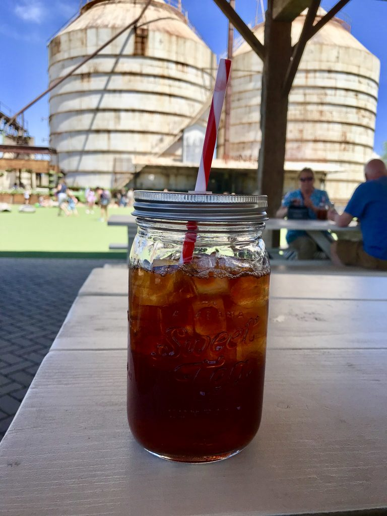 Sweet tea in foreground of Magnolia Silos
