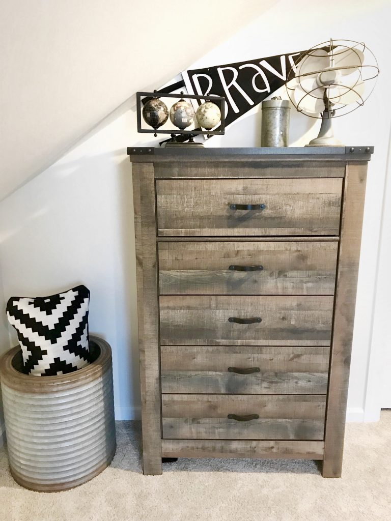 chest of drawers with black and white decor
