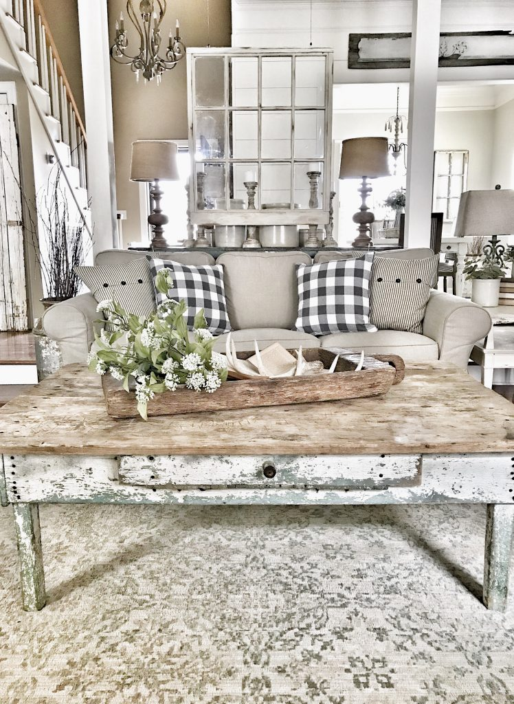 antique coffee table with greenery