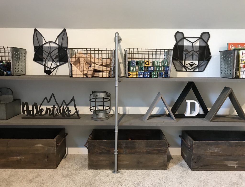 shelf with kids toys and nursery decor