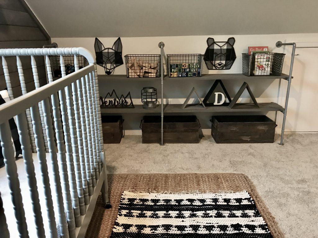 pipe shelf behind crib