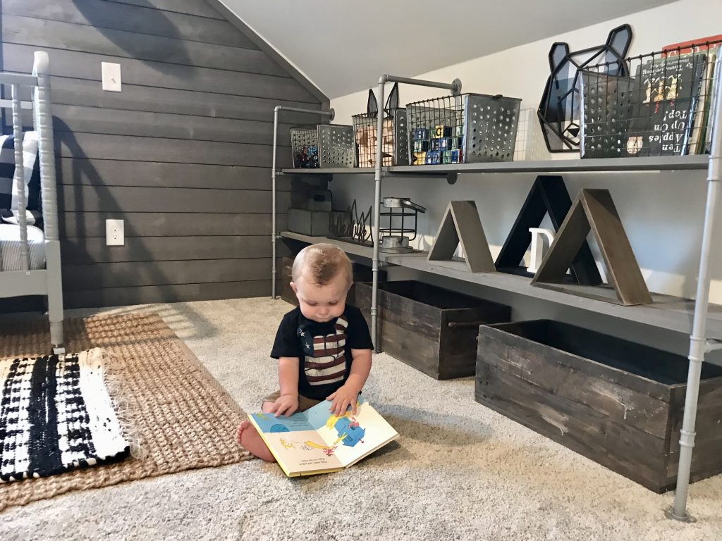 pipe shelving in nursery decorated