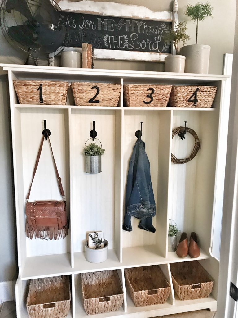 wooden cubbies with baskets and plants