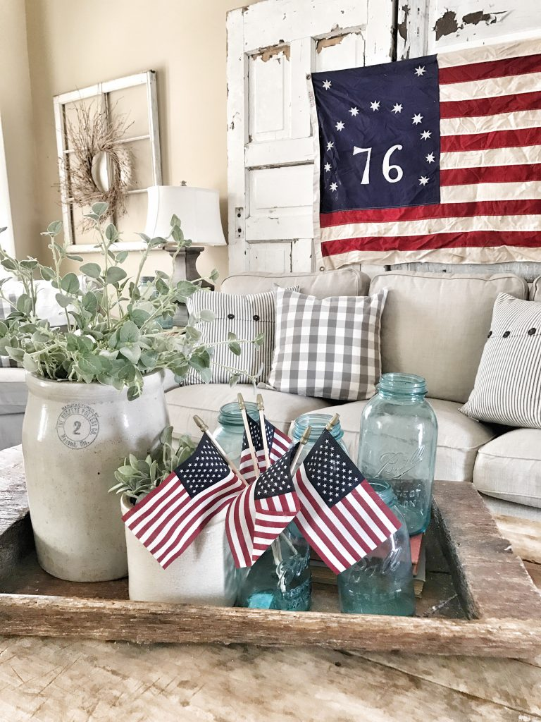 coffee table close up with blue mason jars and small us flags