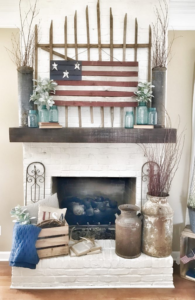 painted rustic us flag hung above living room mantel