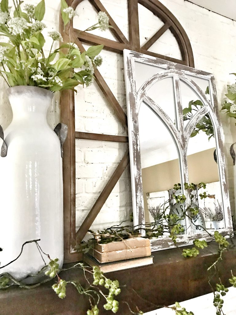 mantel with decor and greenery