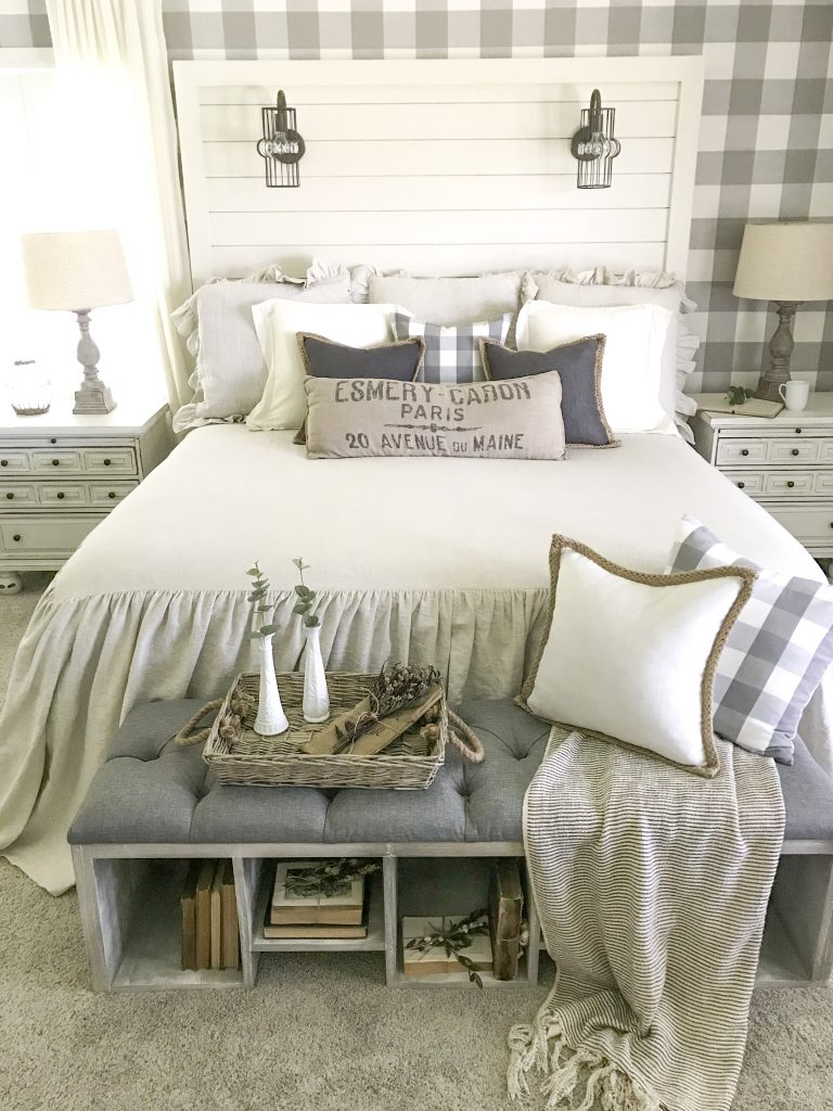 farmhouse bedroom with shiplap bed