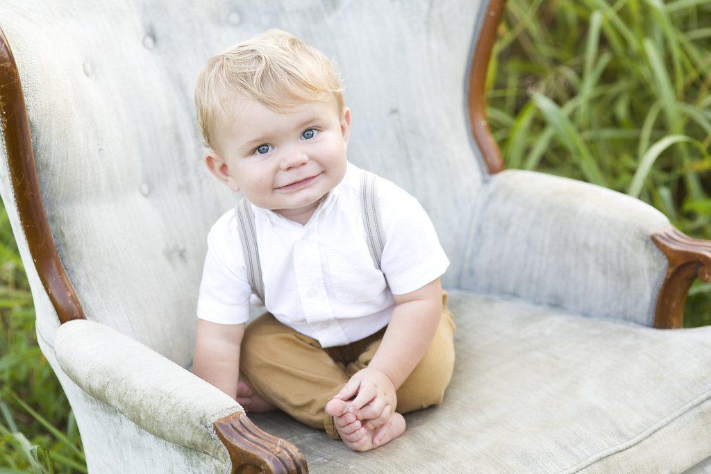toddler boy in antique chair