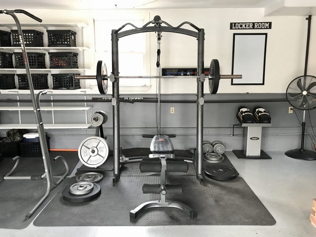 weight bench in clean garage