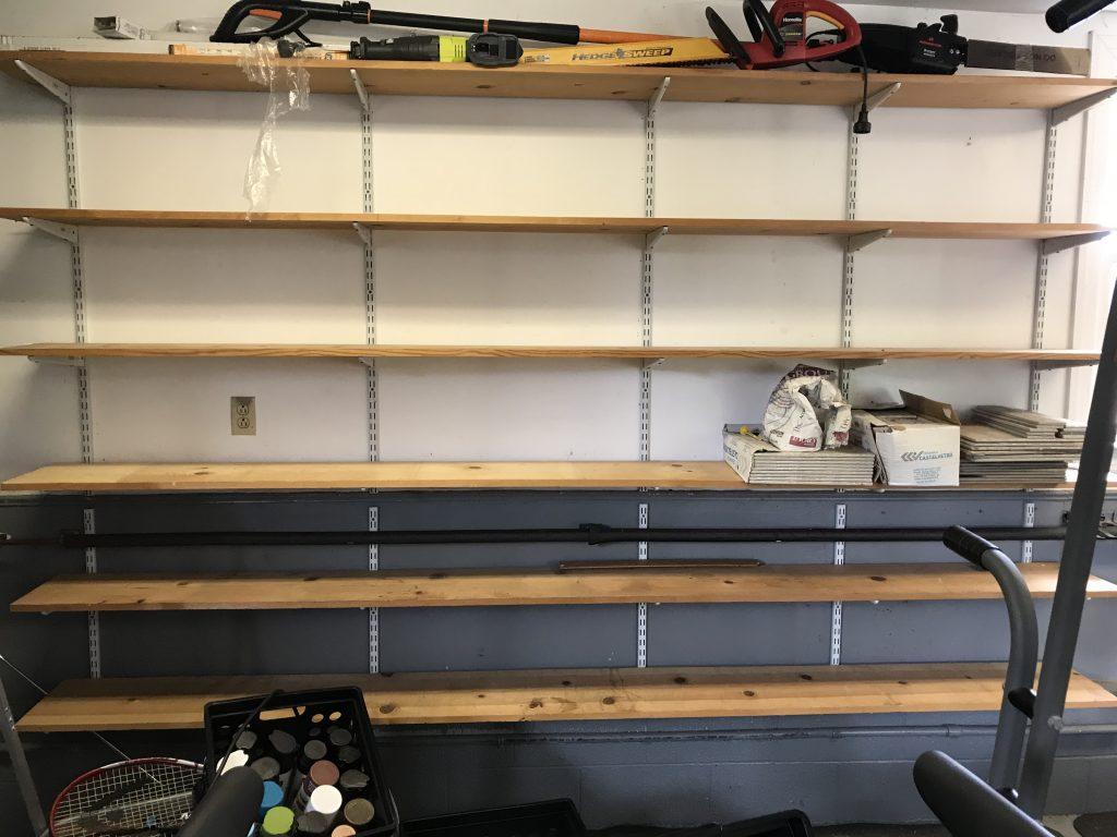 empty wooden shelves in garage