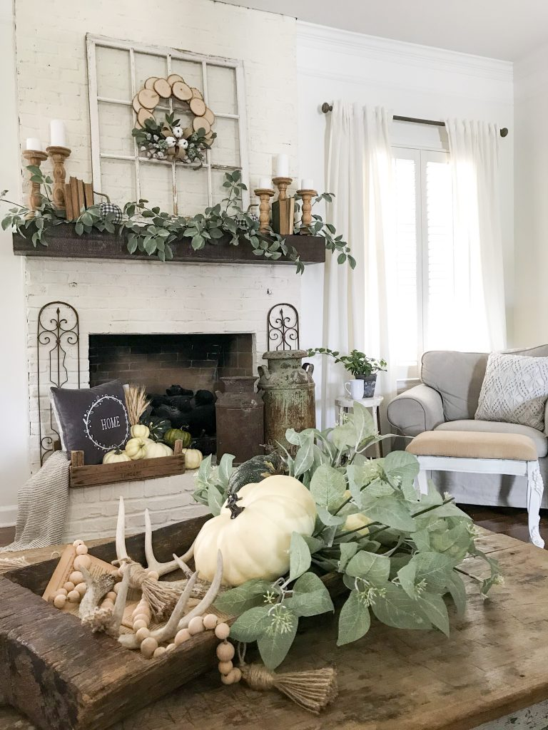 farmhouse living room decorated for fall