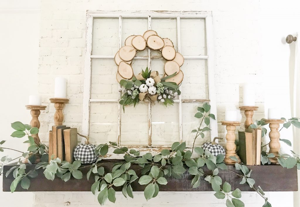 mantel with white vintage window and checkered pumpkins