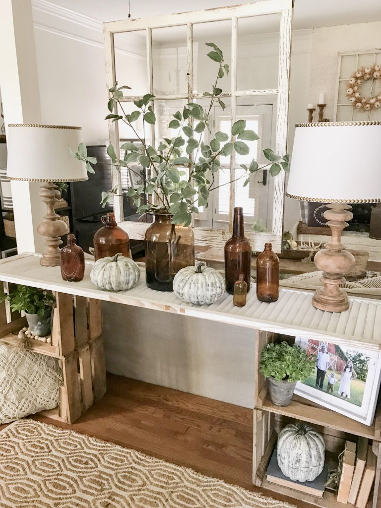 amber bottles on console table