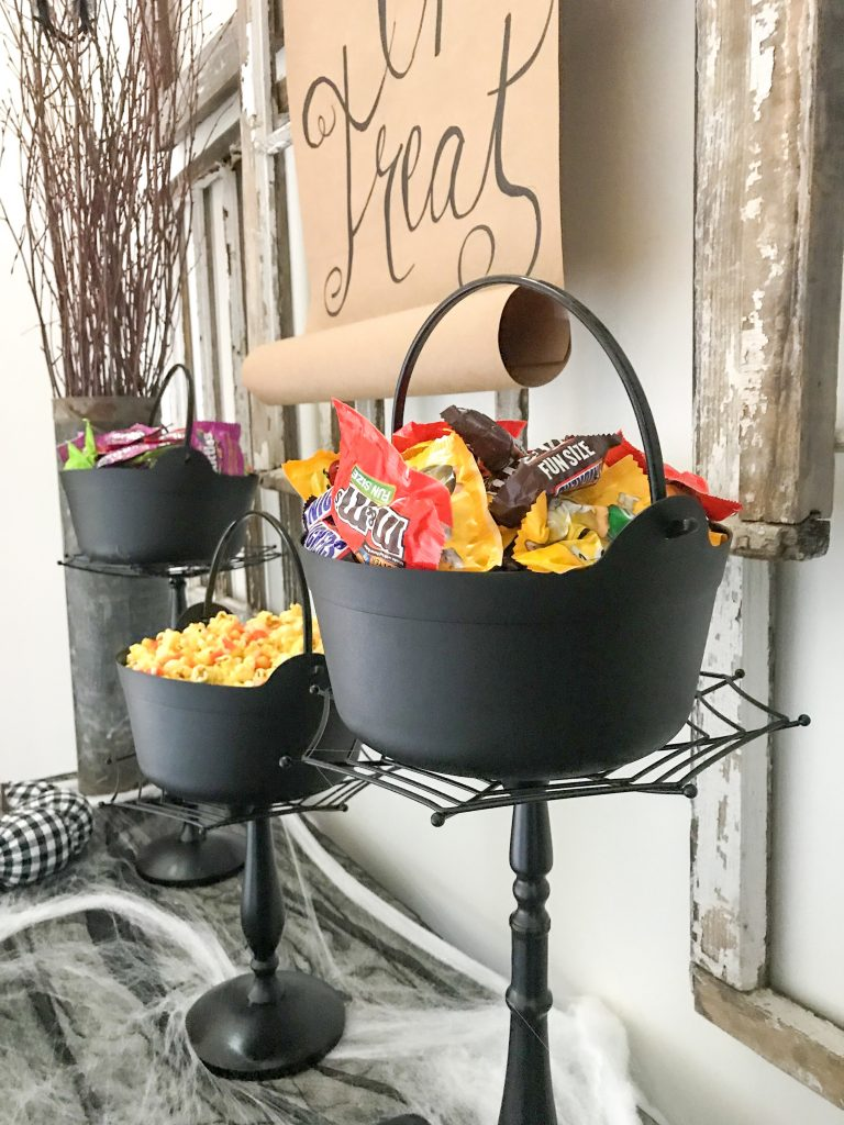 Halloween candy buckets on stands