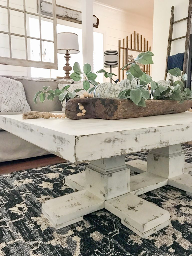 corner view of white coffee table