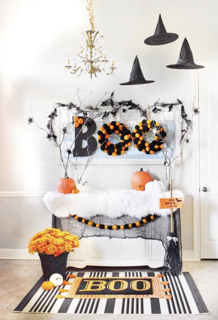 Halloween entryway with floating witch hats