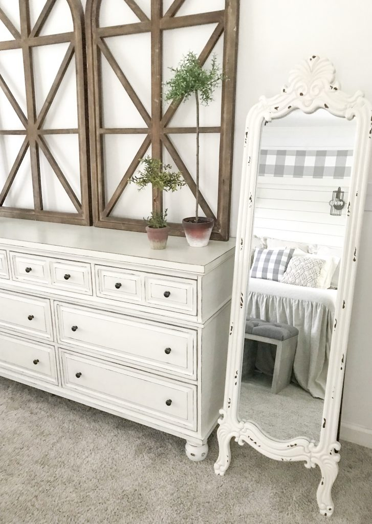 white mirror and dresser with wooden arches