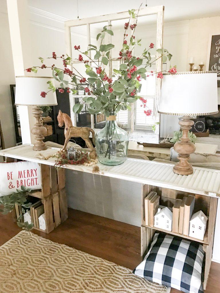 console table with Rae Dunn Christmas decor