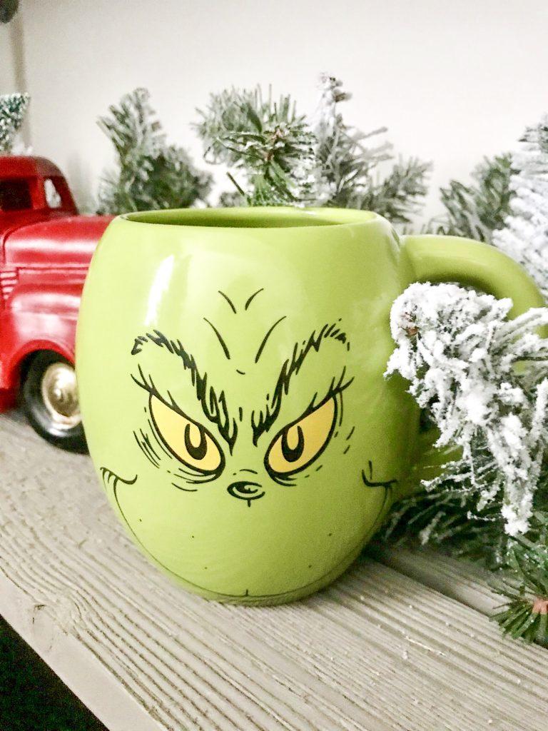 Grinch coffee mug on shelf
