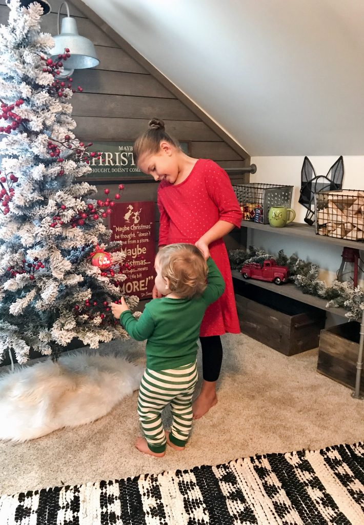children near Christmas tree