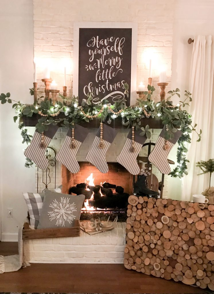 white brick fireplace decorated for Christmas