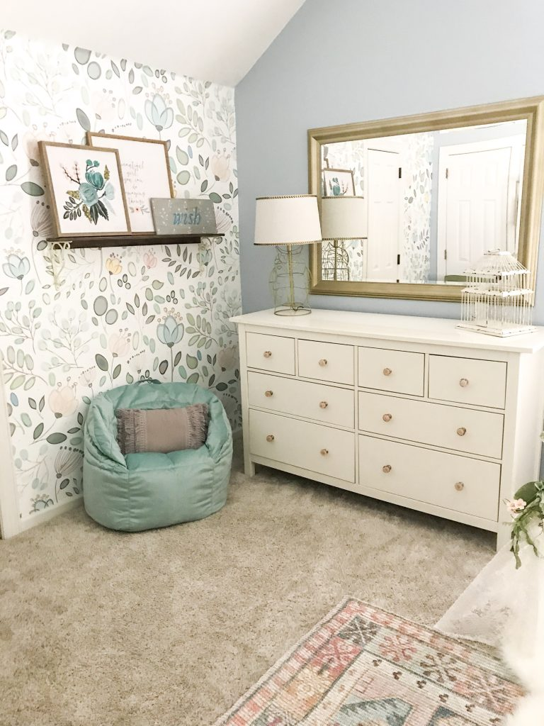 dresser and comfortable chair in girl's room