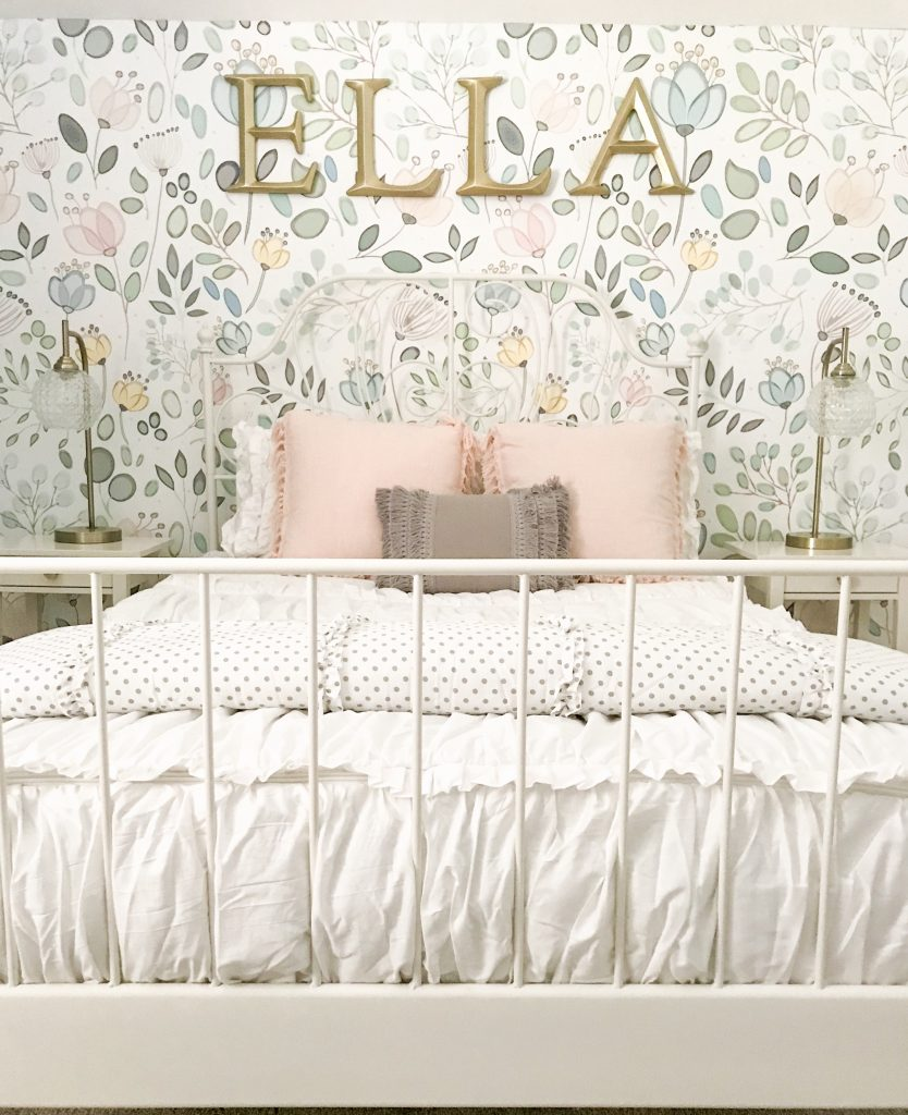 wallpaper focal point wall with gold letters spelling ella