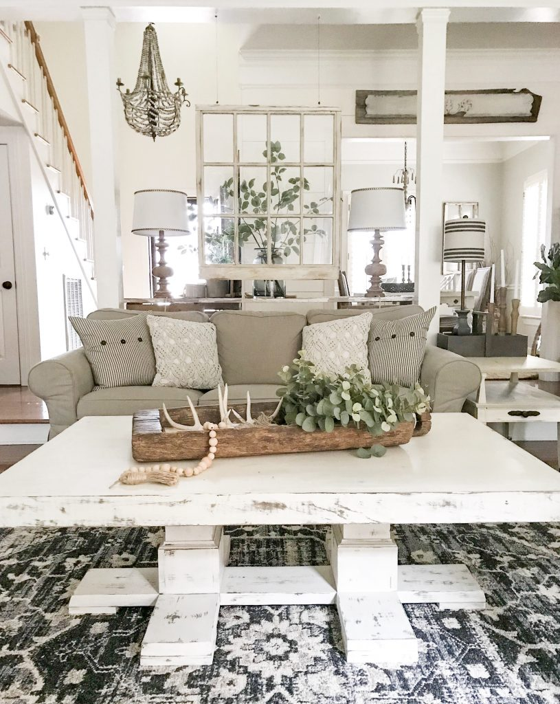 neutral living room with white coffee table