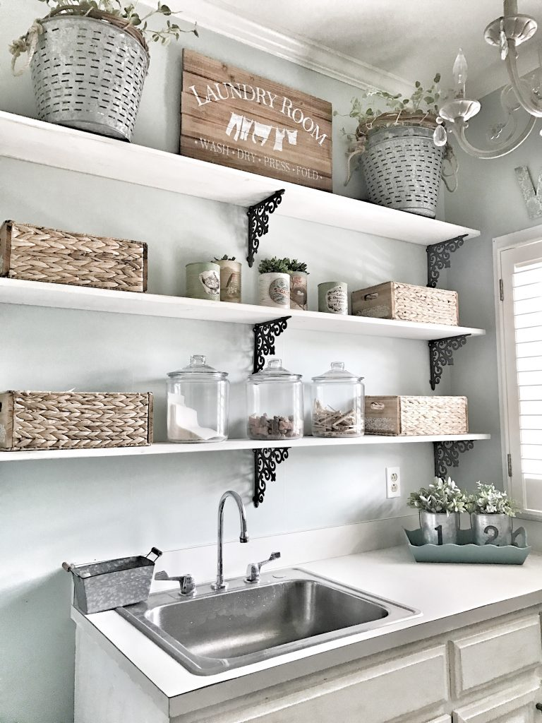 shelving with laundry room decor