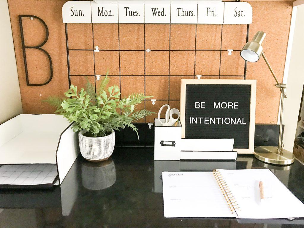 calendar on cork board in desk area