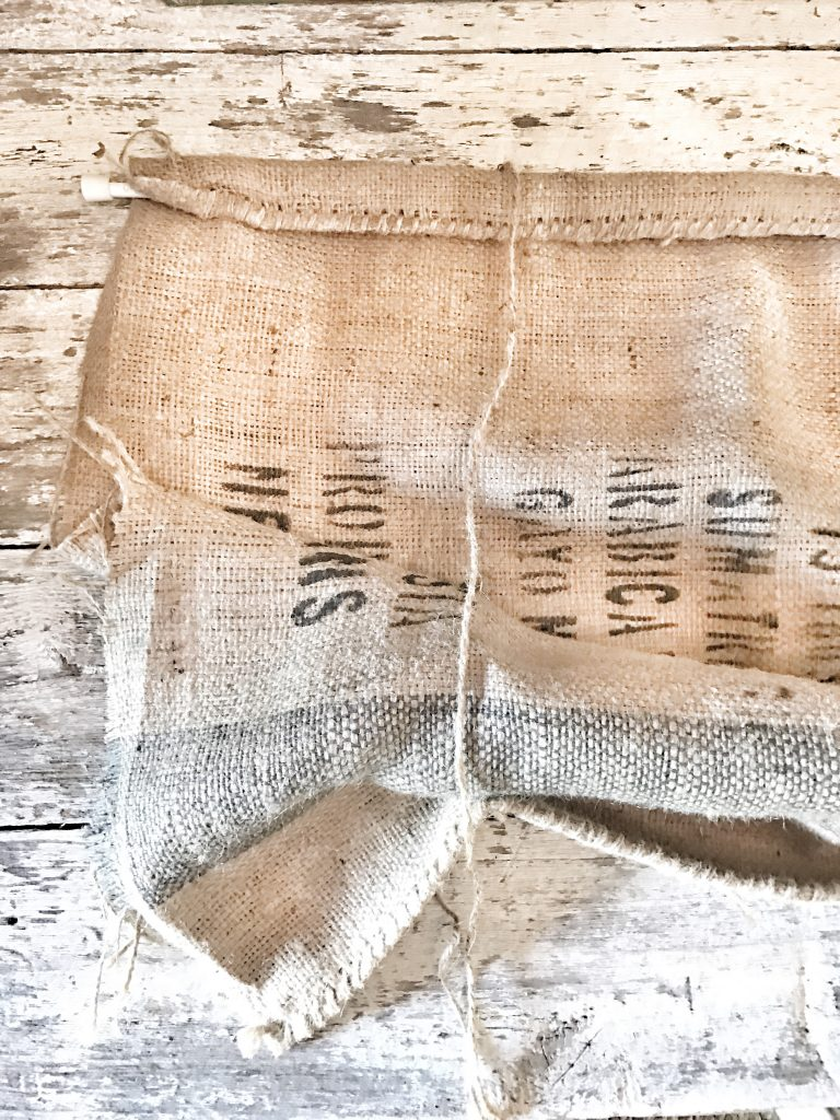 burlap sack with rod and twine