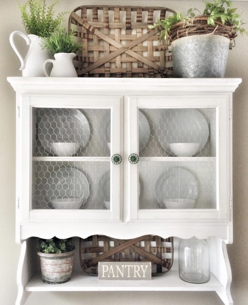 white wooden hutch decorated with small tobacco baskets