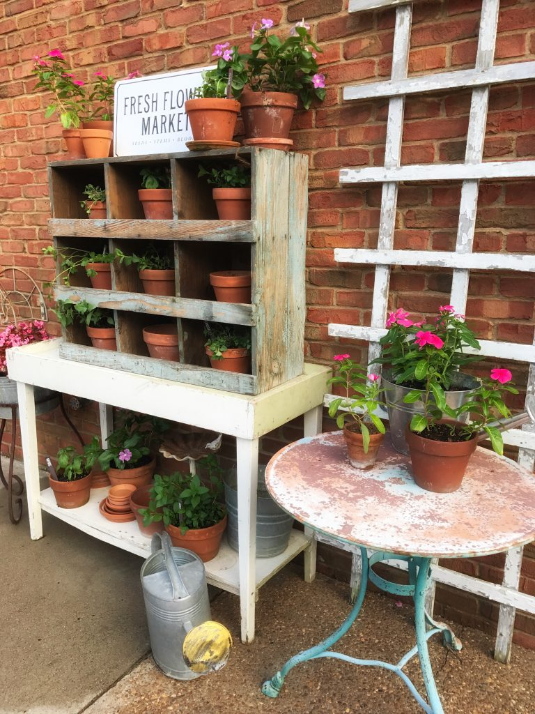 herb garden planter and antique table with flowers