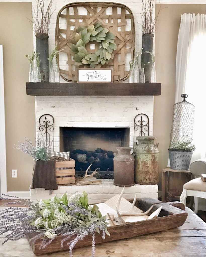 painted white fireplace with rustic decor