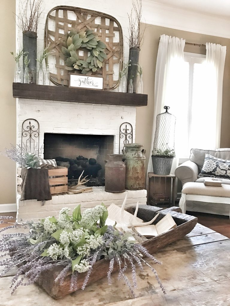 painted white brick fireplace with brown mantel