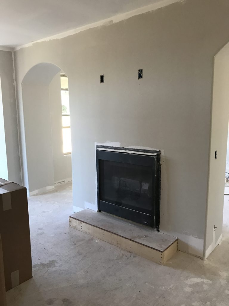 empty kitchen with fireplace