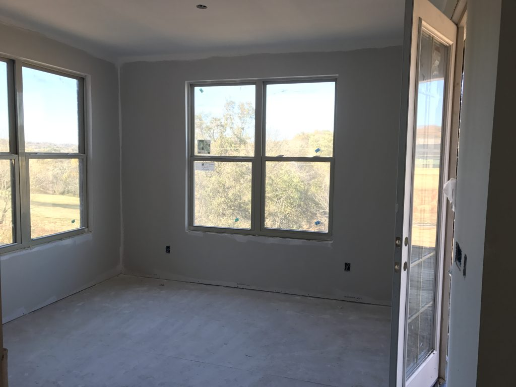 empty kitchen eating area with 2 windows
