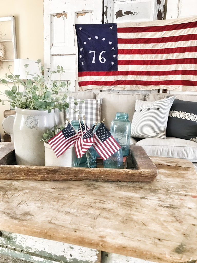 coffee table with small us flags