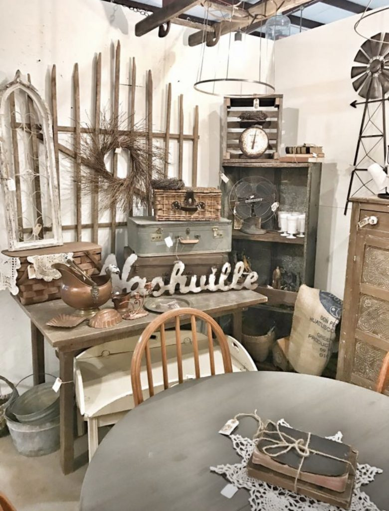 antique booth table with old suitcases and antiques