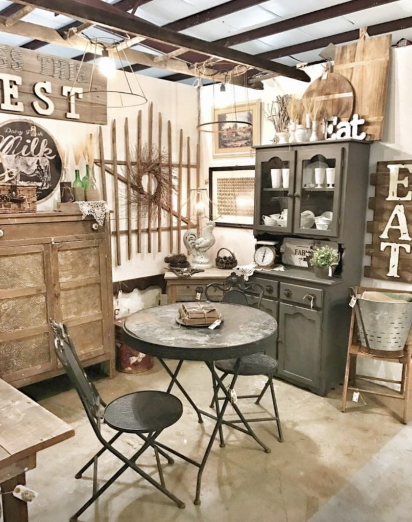 antique booth with farmhouse decor and black antique table