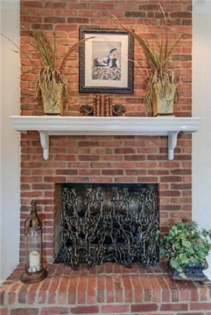 dated red brick fireplace